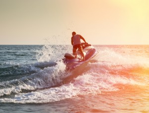 Man on jet ski in sunset
