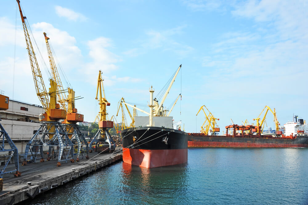 Cargo ship at dock with cranes